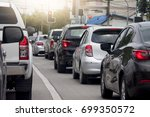 cars on the road heading... | Shutterstock . vector #699350572