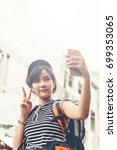 pretty female girl tourist... | Shutterstock . vector #699353065