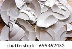 many white broken plates on a... | Shutterstock . vector #699362482