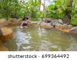 woman in the thermal springs in ... | Shutterstock . vector #699364492