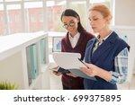 work process in spacious open... | Shutterstock . vector #699375895