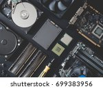Small photo of top view of computer parts with harddisk, ram, CPU, graphics card, solid state drive (SSD), motherboard, tools on black steel background.