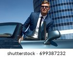 businessman in the car. luxury... | Shutterstock . vector #699387232