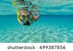 snorkeling woman exploring... | Shutterstock . vector #699387856