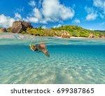 snorkeling woman exploring... | Shutterstock . vector #699387865