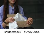 young woman opening box with... | Shutterstock . vector #699392056