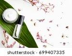 white cream bottle placed ... | Shutterstock . vector #699407335