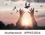 woman praying and free bird... | Shutterstock . vector #699421816