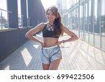 long haired sporty girl in a... | Shutterstock . vector #699422506