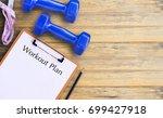 flat lay   blue dumbbell ... | Shutterstock . vector #699427918