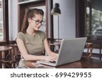 business woman using laptop at... | Shutterstock . vector #699429955