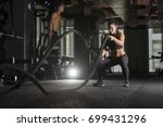 strong athlete woman wearing a...   Shutterstock . vector #699431296