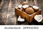 fresh coconuts in an old box.... | Shutterstock . vector #699432502