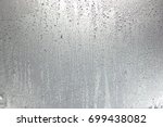 drops on gray background   Shutterstock . vector #699438082