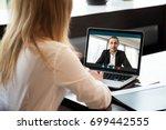 businesswoman making video call ...