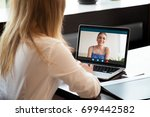 two young women chatting online ... | Shutterstock . vector #699442582