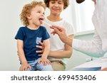 portrait of cheerful little boy ...   Shutterstock . vector #699453406