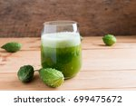 herbal juice of green momodica  ... | Shutterstock . vector #699475672