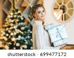 beautiful teen girl with gifts  | Shutterstock . vector #699477172