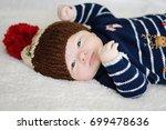 cute newborn baby in warm wool...   Shutterstock . vector #699478636