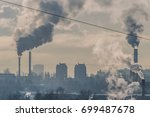 dirty city with pollution pipes | Shutterstock . vector #699487678