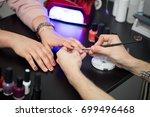 closeup shot man making... | Shutterstock . vector #699496468