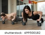 gym man and woman push up... | Shutterstock . vector #699500182