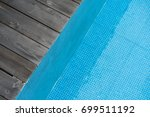 wooden plank deck with blue... | Shutterstock . vector #699511192
