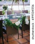 a dinner table for bride... | Shutterstock . vector #699534556