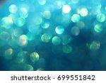 aqua blue iridescent confetti... | Shutterstock . vector #699551842