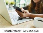 woman use smartphone on desk in ...   Shutterstock . vector #699556468