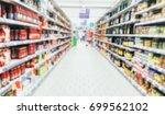 defocused supermarket aisle... | Shutterstock . vector #699562102