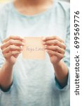 woman holds adhesive note with...   Shutterstock . vector #699569776