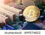 close up golden bitcoin coin... | Shutterstock . vector #699574822