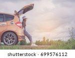 hipster woman traveler sitting... | Shutterstock . vector #699576112
