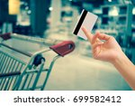 hand hold blank credit card on...   Shutterstock . vector #699582412