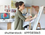 pretty talented female painter... | Shutterstock . vector #699585865