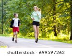 young family jogging in the... | Shutterstock . vector #699597262