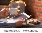 hot black coffee with cookies... | Shutterstock . vector #699668296