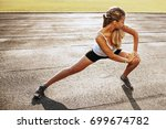 strong beautiful sporty female... | Shutterstock . vector #699674782