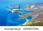 airplane is flying over amazing ... | Shutterstock . vector #699697096