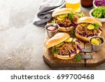 pulled pork sandwiches with bbq ... | Shutterstock . vector #699700468