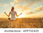 peaceful meditation at sunset.  | Shutterstock . vector #699731425