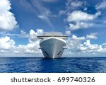 cruise ship in crystal blue... | Shutterstock . vector #699740326