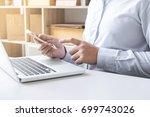 happiness man using smart phone ... | Shutterstock . vector #699743026