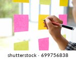 hand point sticky note reminder ... | Shutterstock . vector #699756838