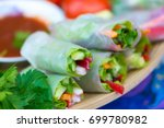 spring rolls with vegetables... | Shutterstock . vector #699780982