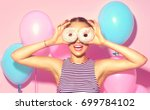 beauty girl holding donuts and... | Shutterstock . vector #699784102