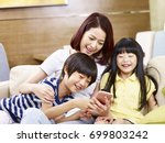 young asian mother and two... | Shutterstock . vector #699803242