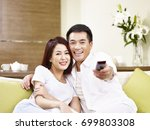 young asian couple sitting on... | Shutterstock . vector #699803308